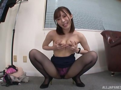 Japanese girl is on her knees blowing and waiting for strong facial