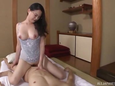 Nerdy amateur Japanese MILF rides her husband at home