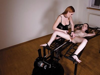 Lesbian tied to a table and ass fucked by her mistress