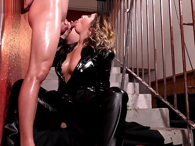 Chick hither leather gets oiled up for sex.
